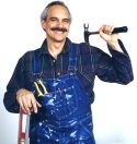 Jerry Alonzy, the Natural Handyman, sporting his traditional paint-stained bib overalls