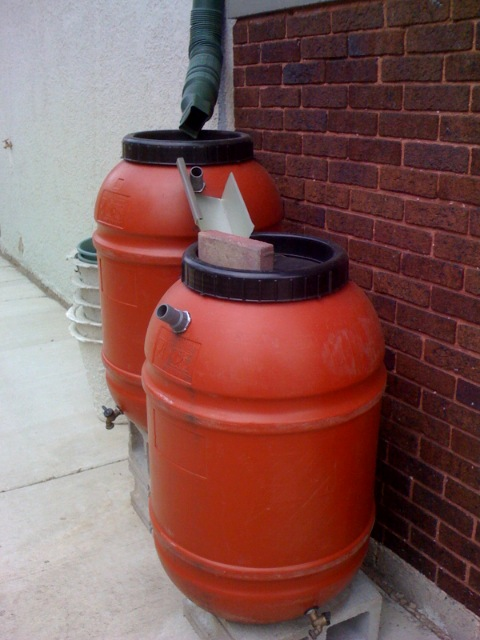 Installing a rainwater collection system rain barrel for Making rain barrel system