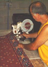 Dan of DWP Carpet Binding performing binding on a carpet