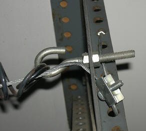 Purpose of and installation of safety cables on garage door springs