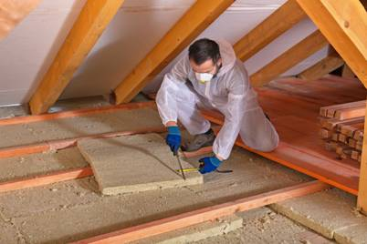 Cut Attic Insulation To Fill Gaps And Voids