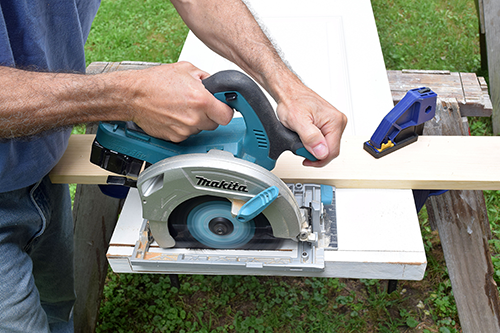 Trim bottom of door with rental circular saw & Tool Rentals for Woodcutting - Installing a new door